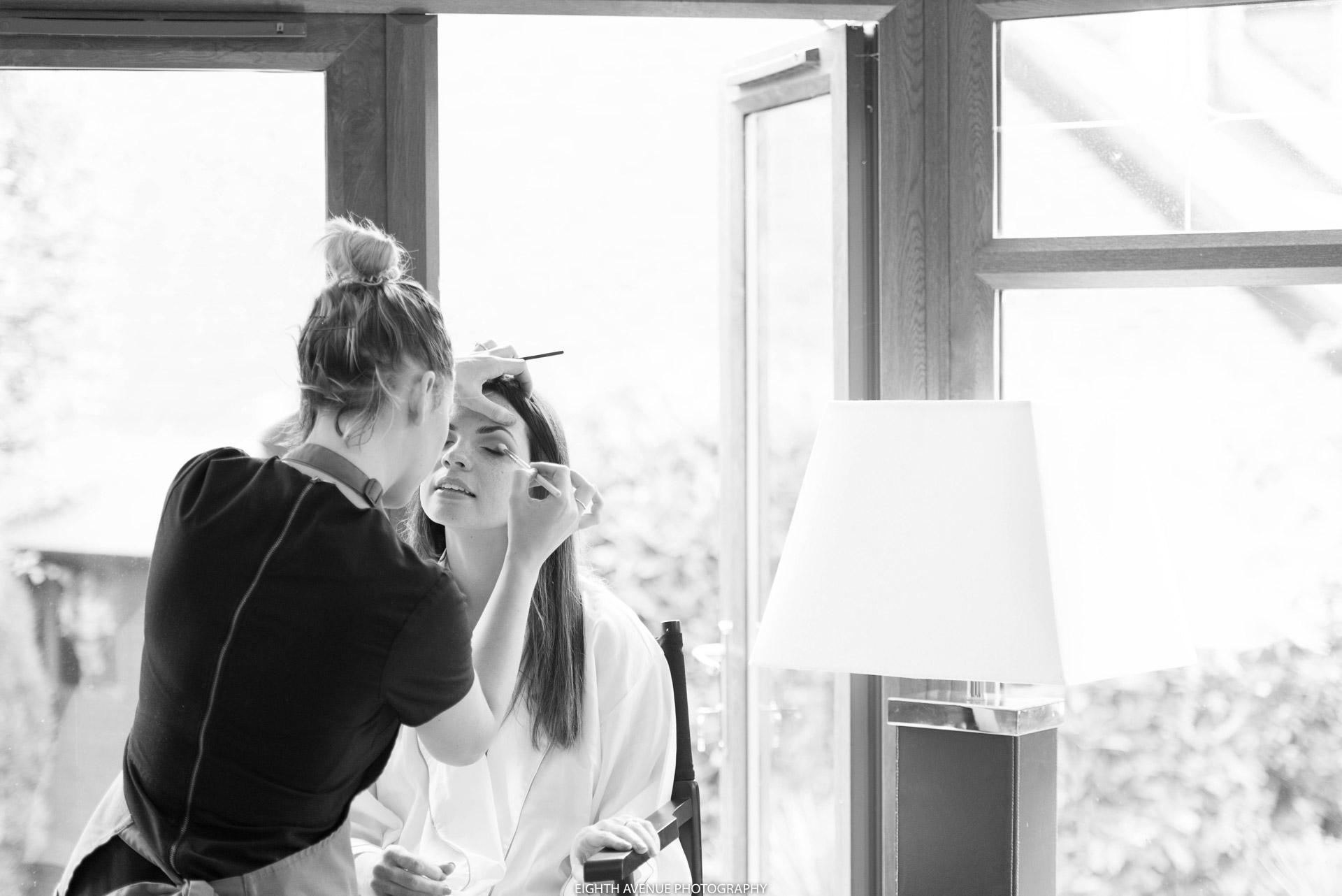 Bride having make up done for wedding