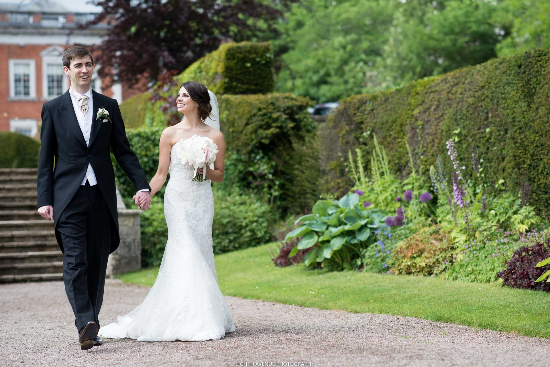 Bride and groom walking at Eaves Hall