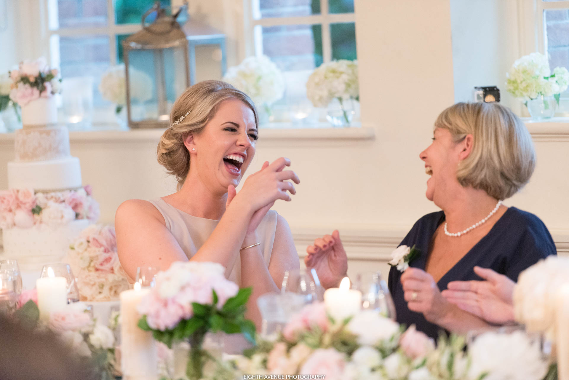 Bridesmaid laughing