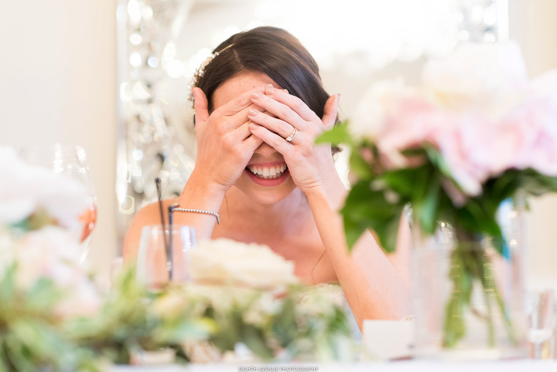 Bride laughign during speeches