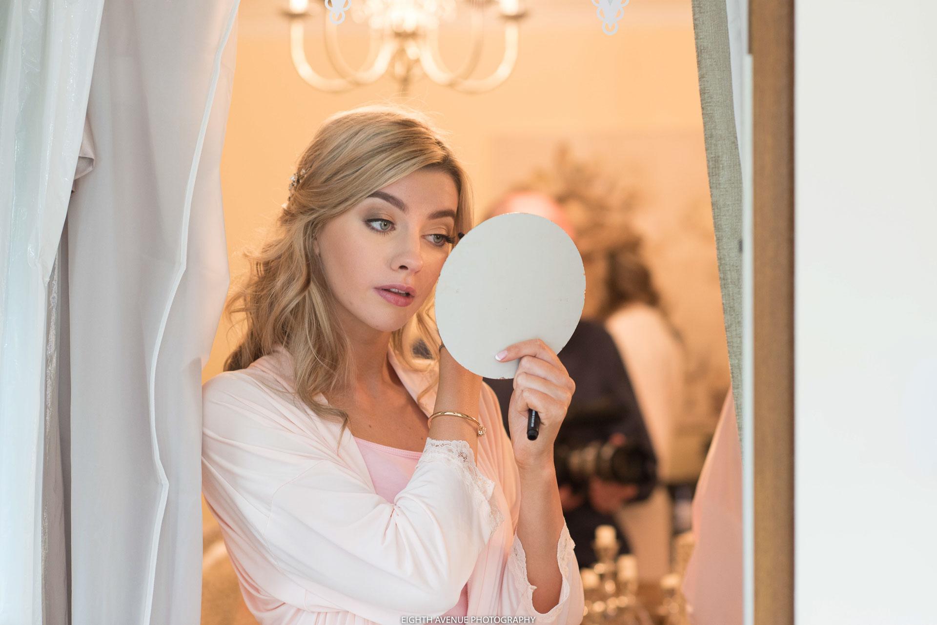 Bridesmaid looking in mirror