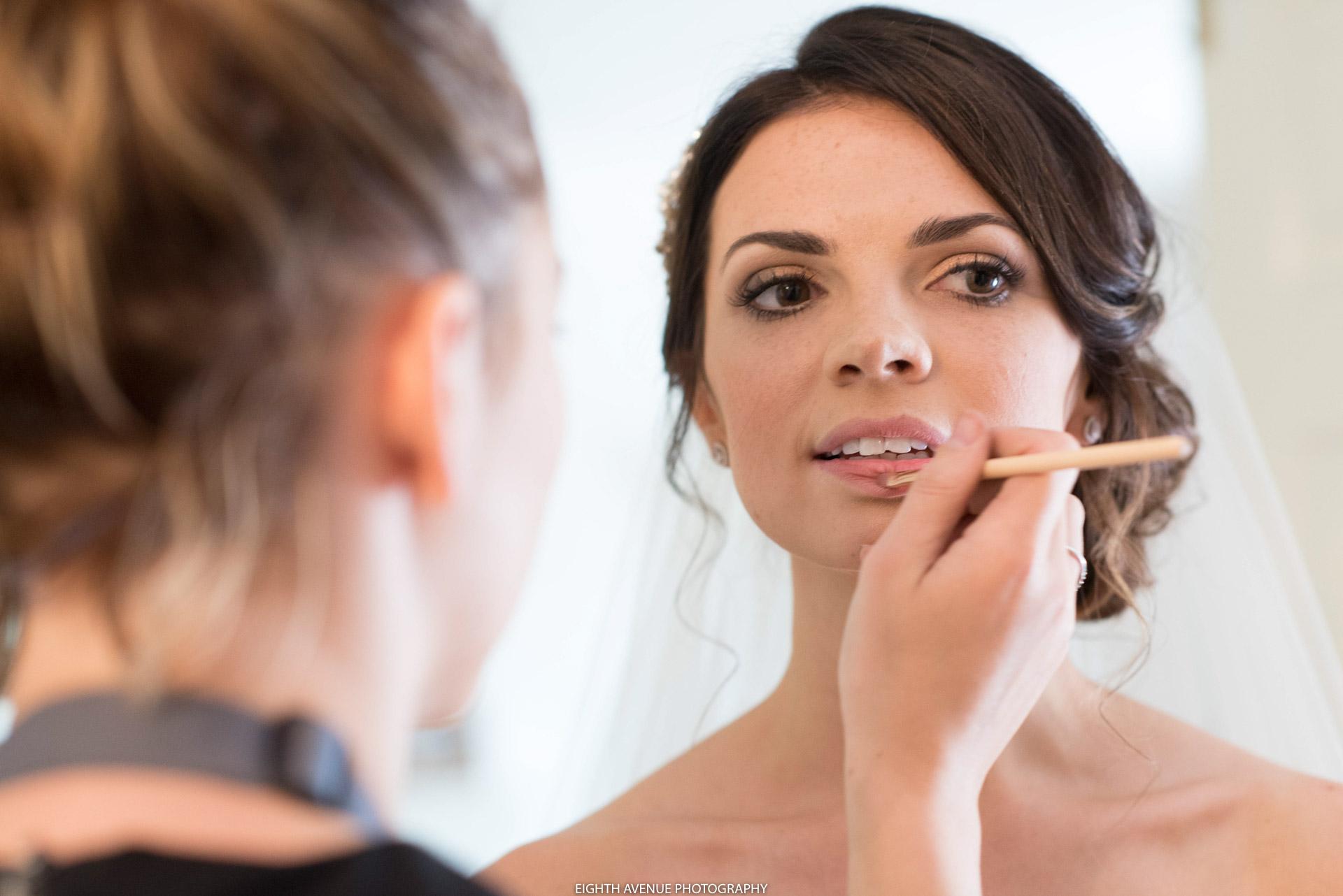 Bride having lip gloss done