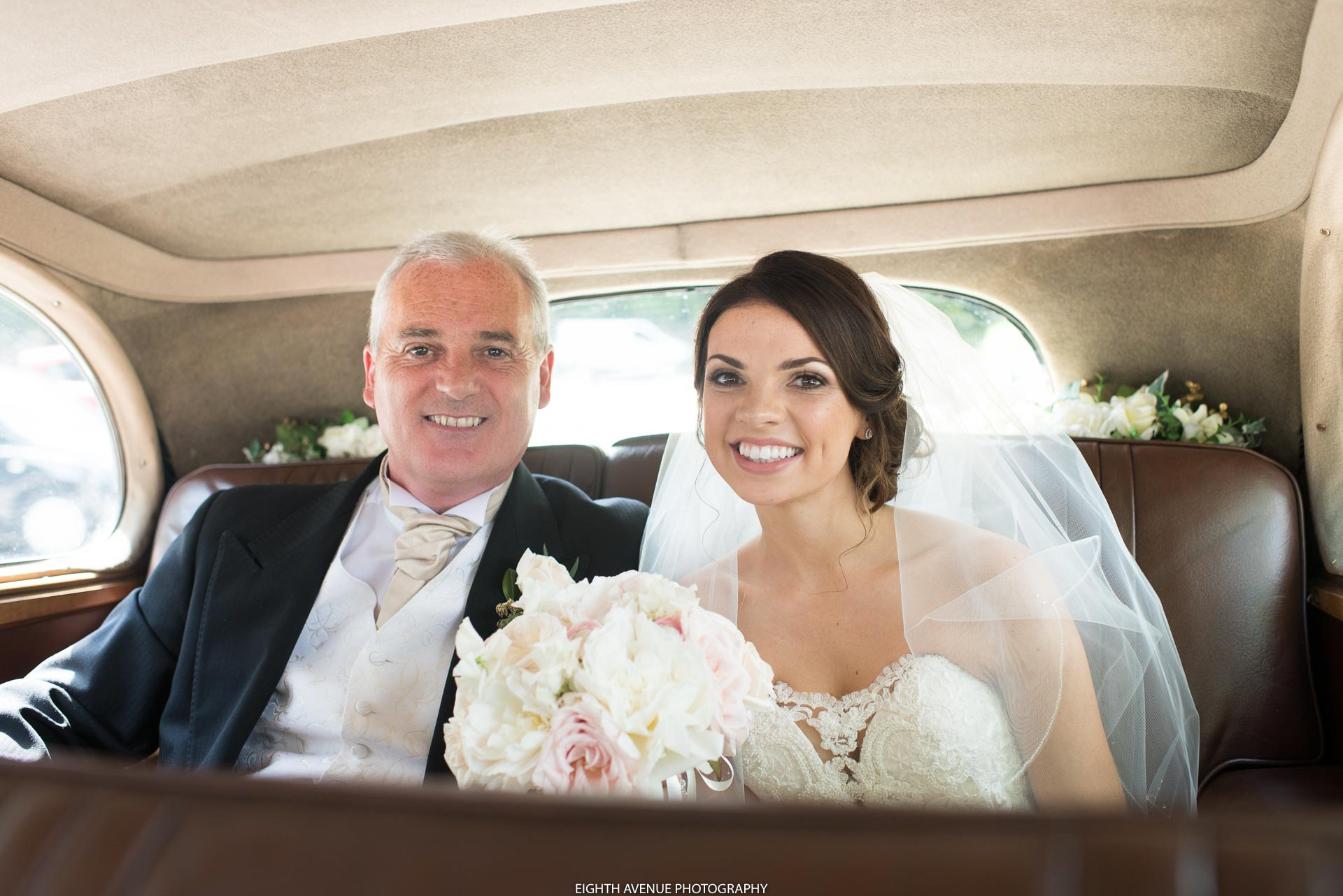 Bride and father of the bride in wedding car
