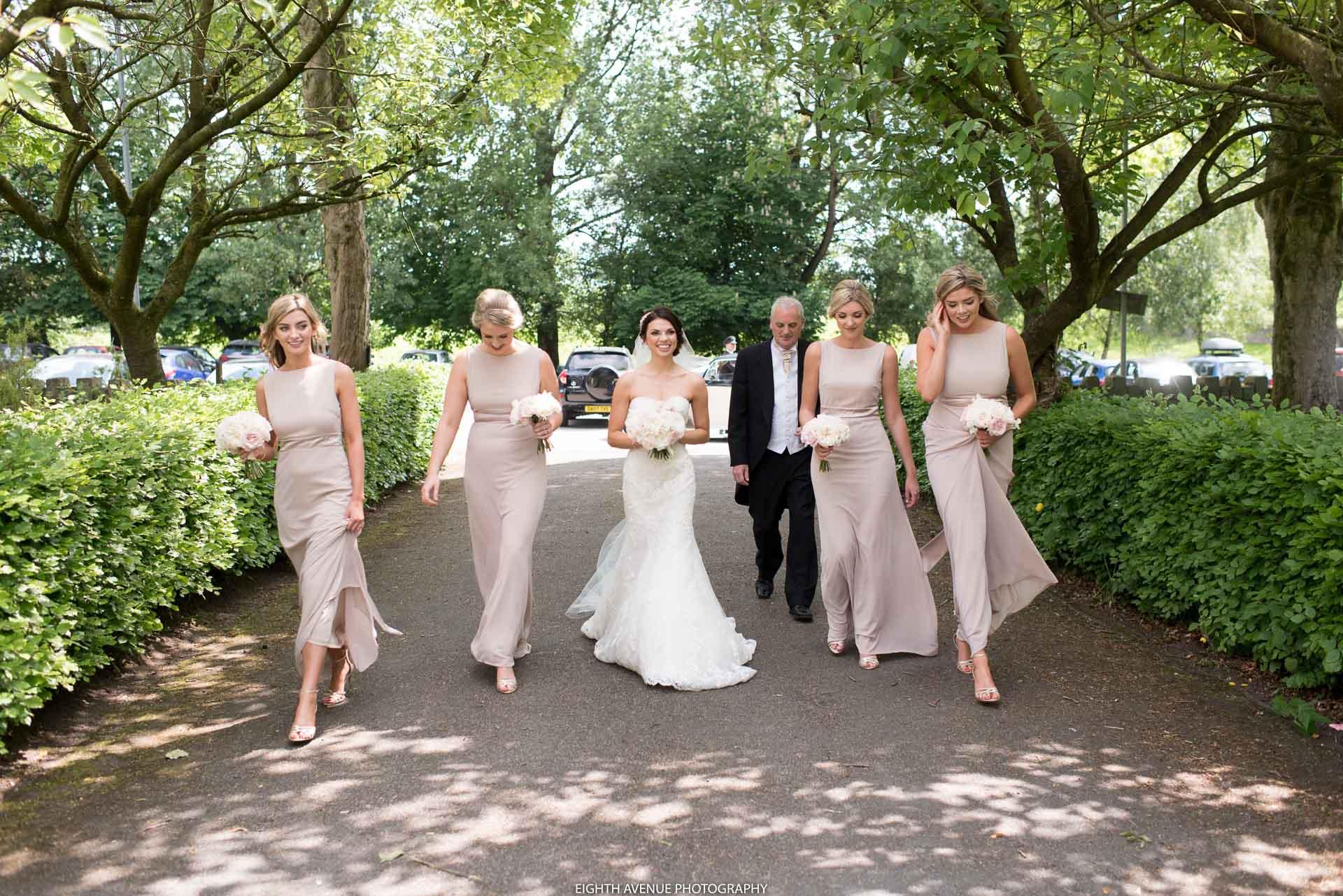 Bridesmaids and bride walking to church