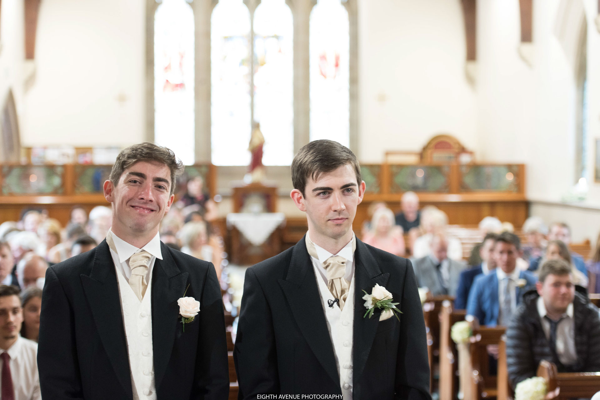 Groom looking nervous in church
