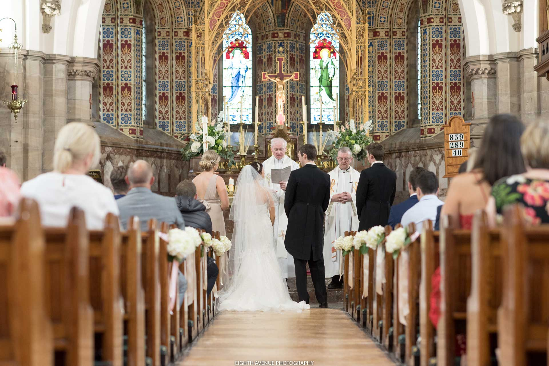 Down the aisle to bride and groom at church wedding