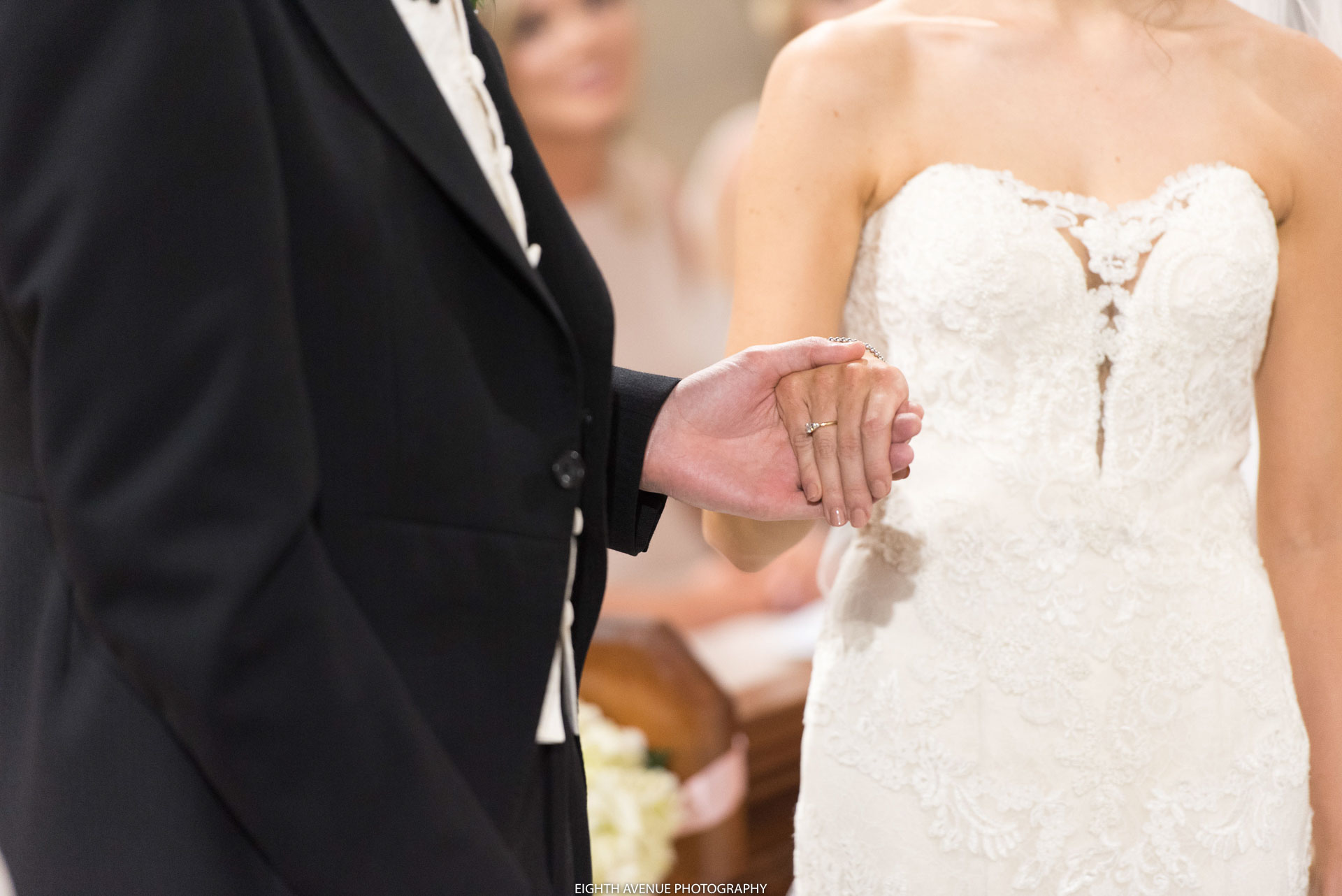 Bride and groom holding hands at wedding