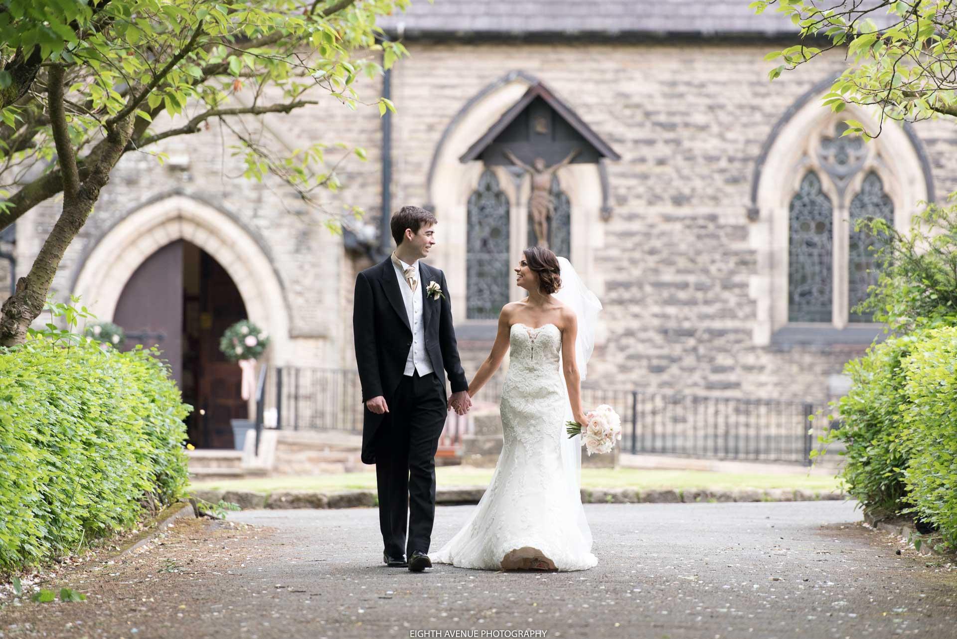 Bride and groom walking away church