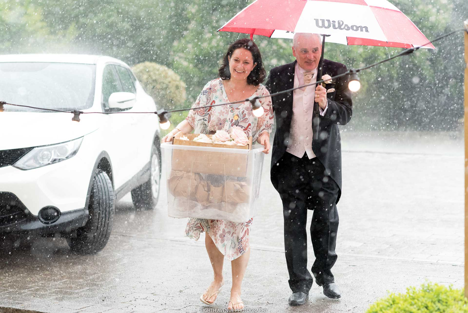 Guests walking in rain