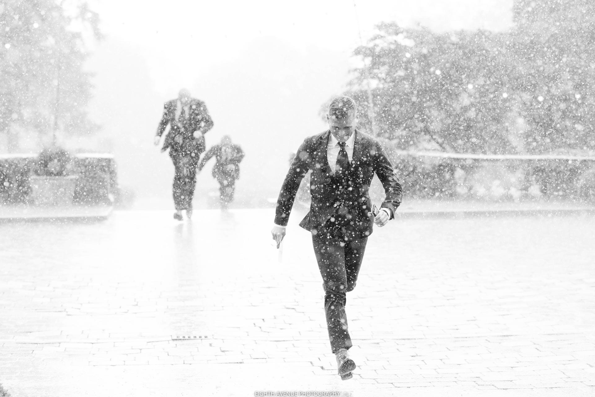 Wedding guest running in rain downpour