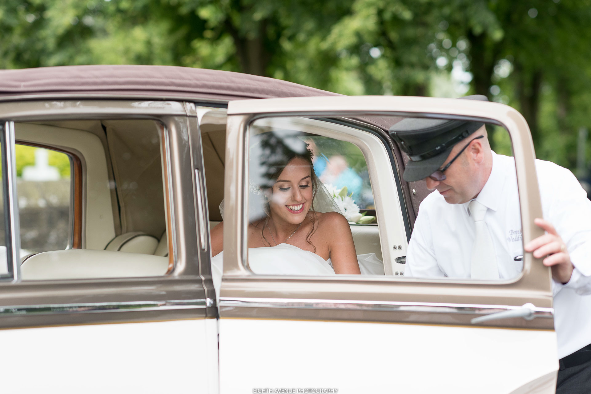 Bride leaving wedding car