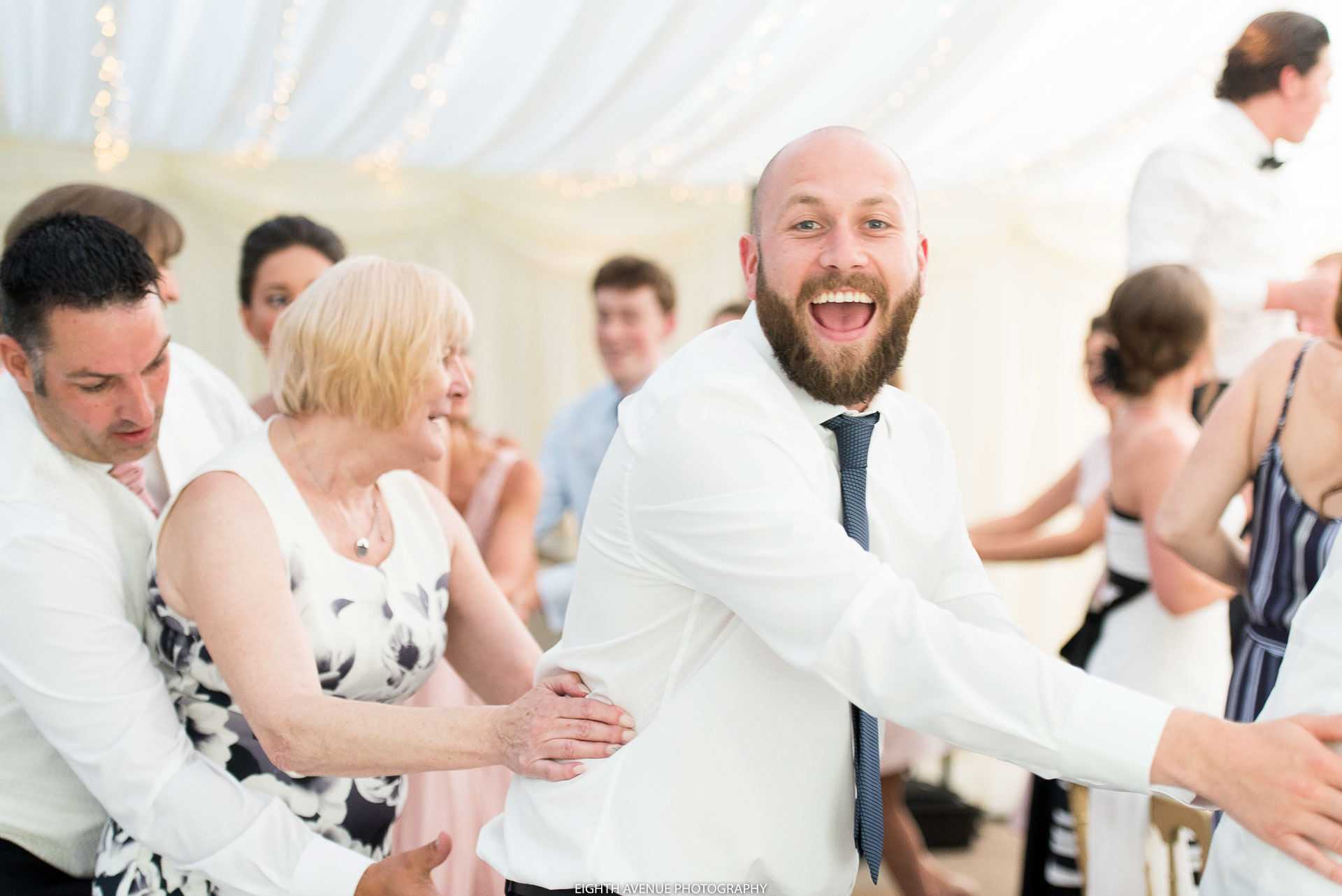 Guest doing the conga at a wedding