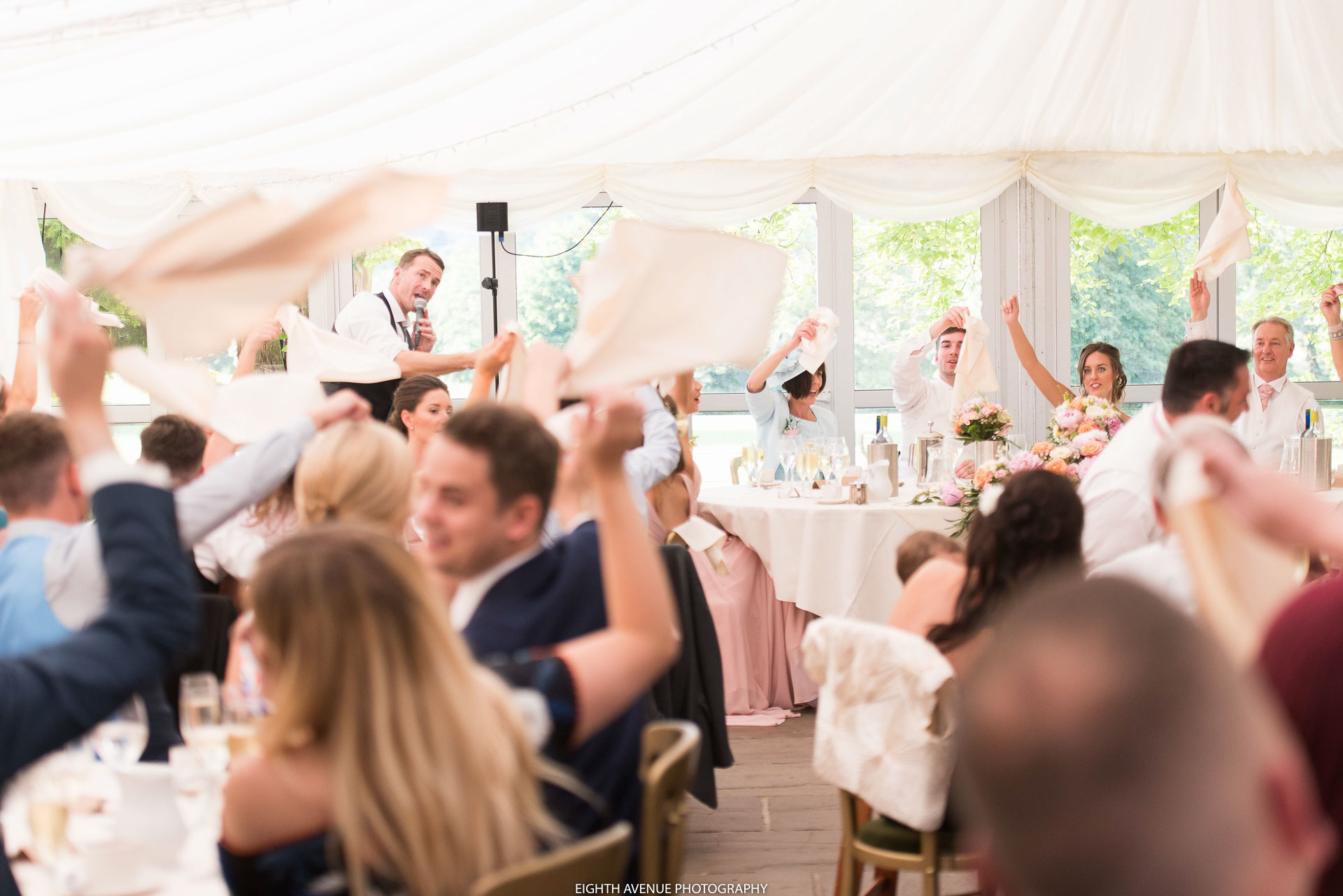 Guests waving napkins at the Inn at Whitewell