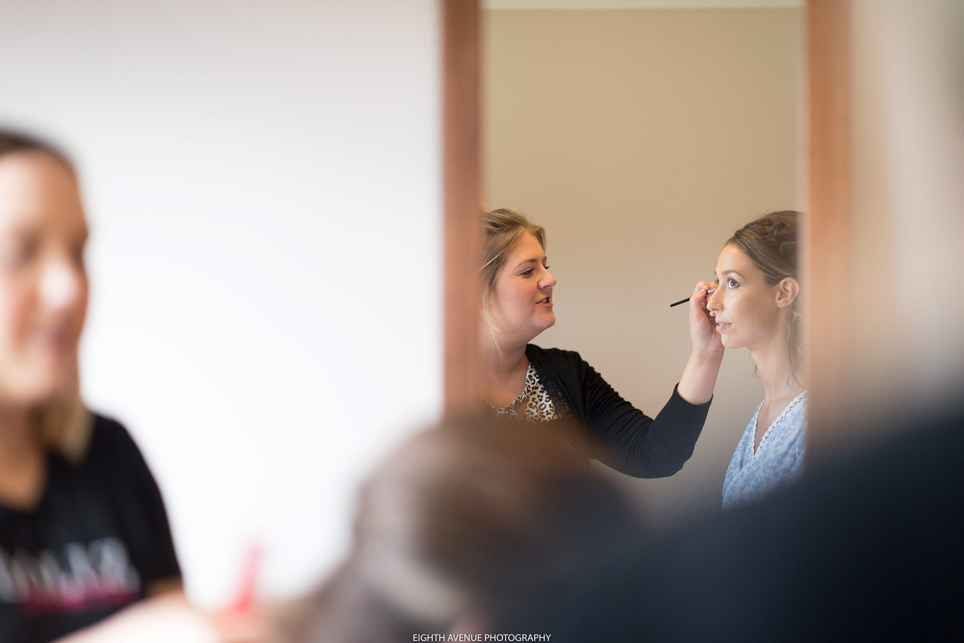 Bridesmaids getting make up done