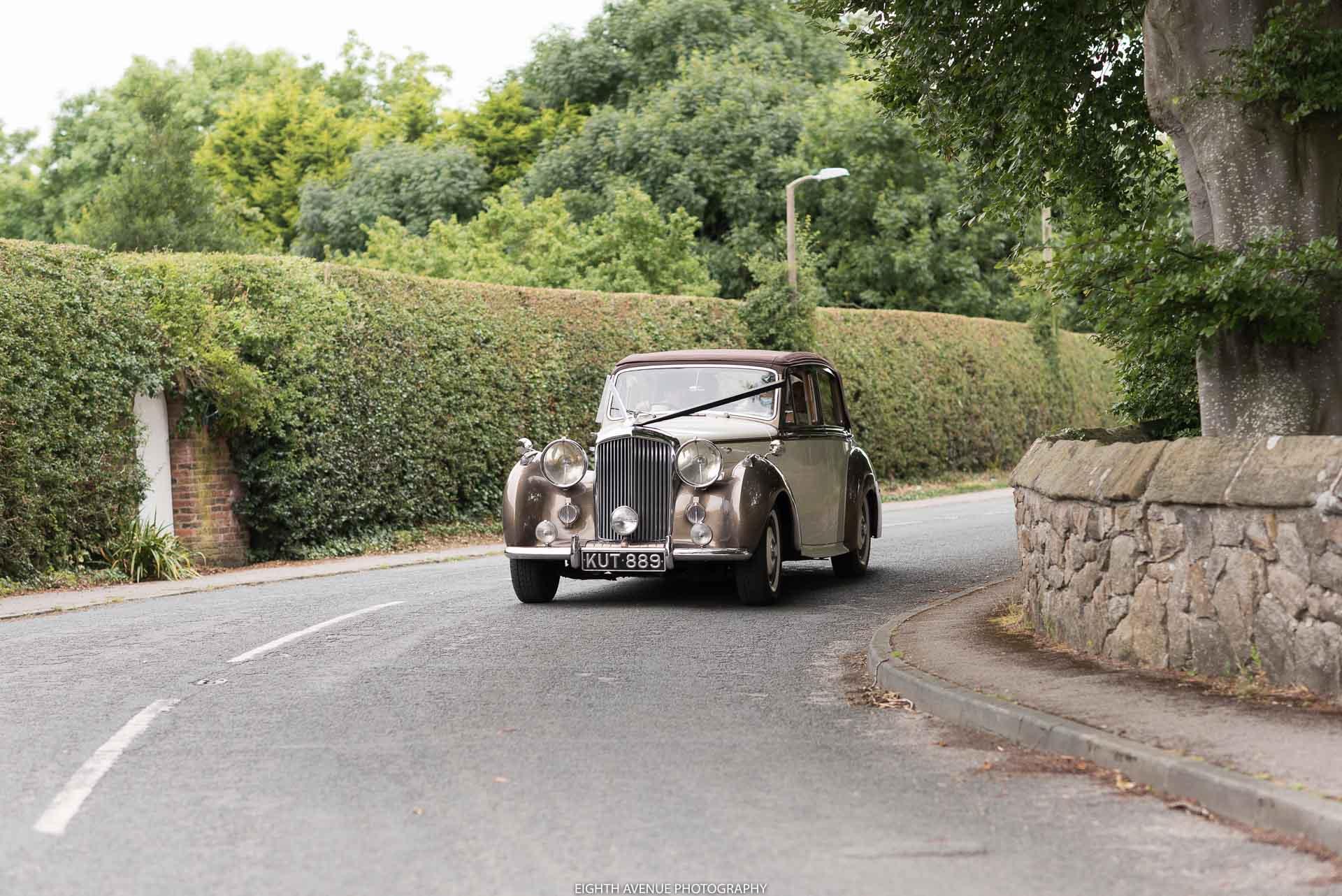 Wedding car arriving at church