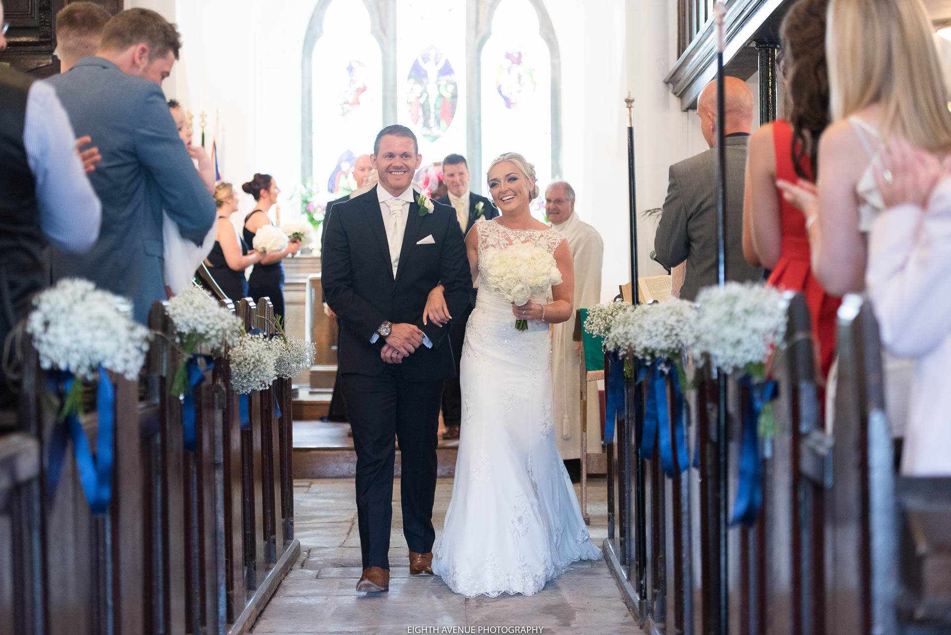 Bride and groom walking down the isle at their church wedding