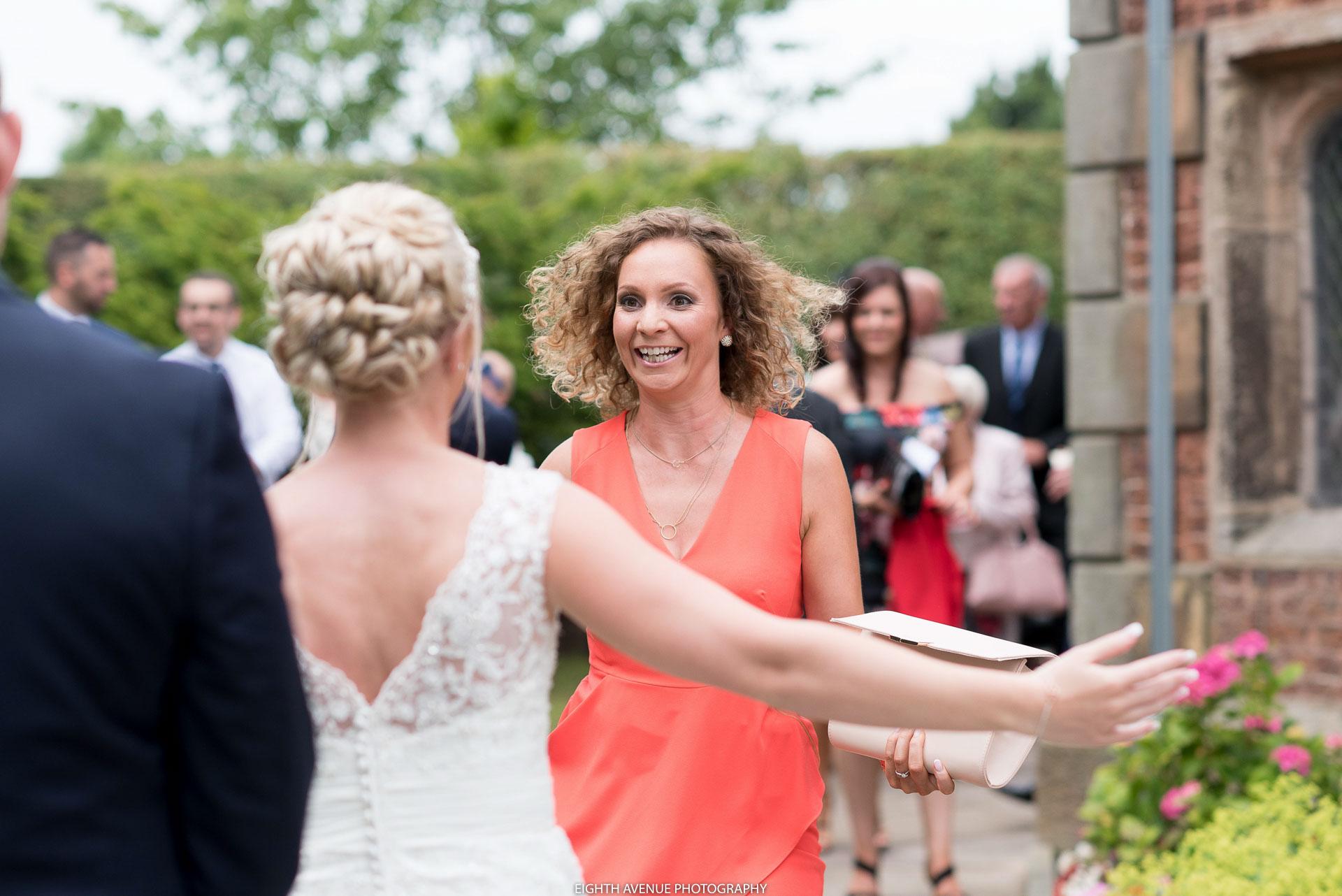 Bride meeting wedding guest outside church