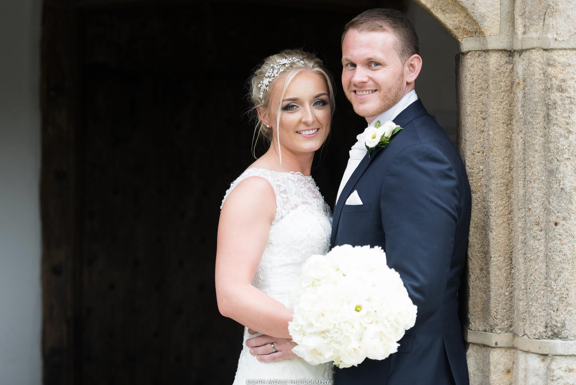 Bride and groom formal photograph at church wedding