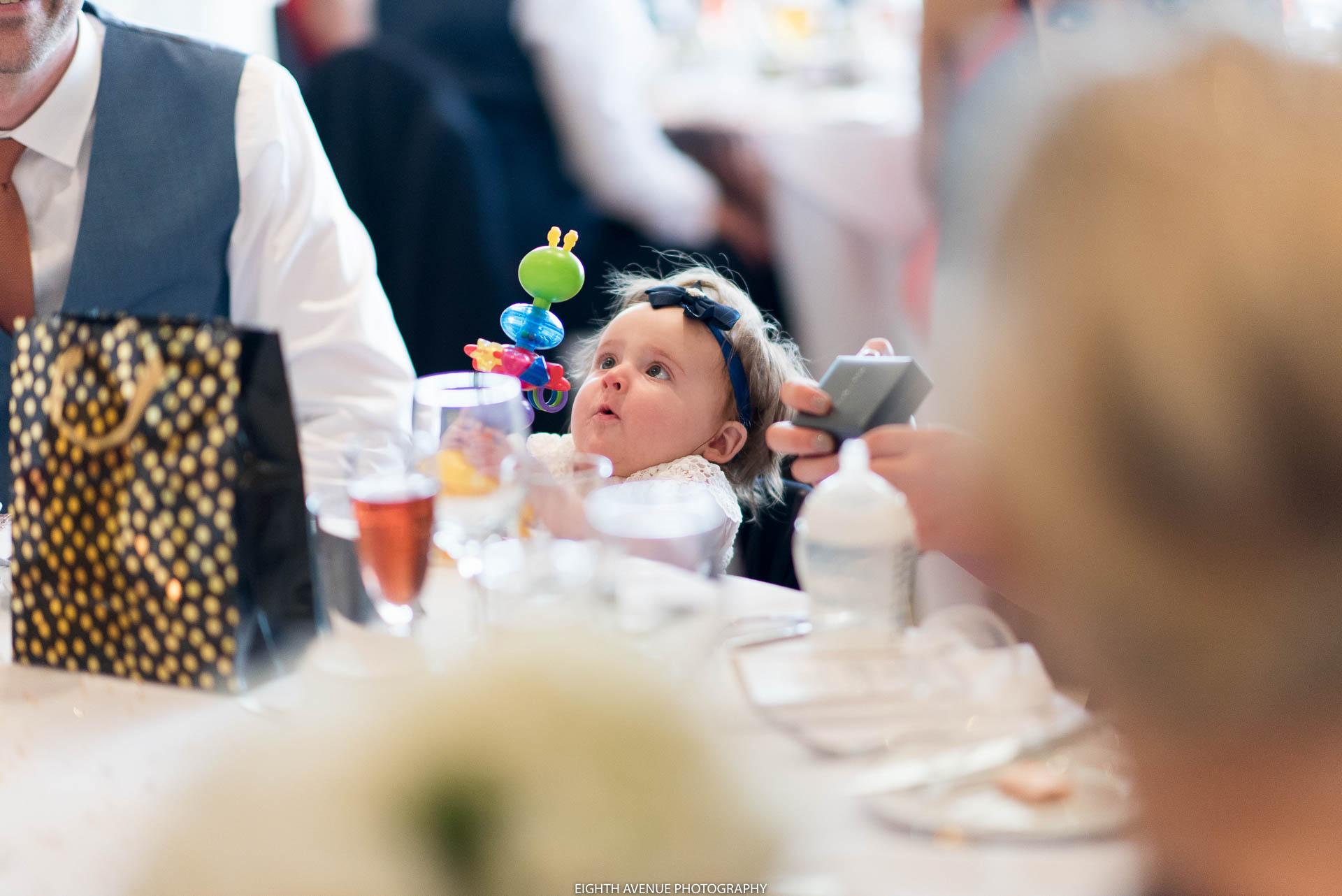 Child looking at toy Beeston manor Wedding