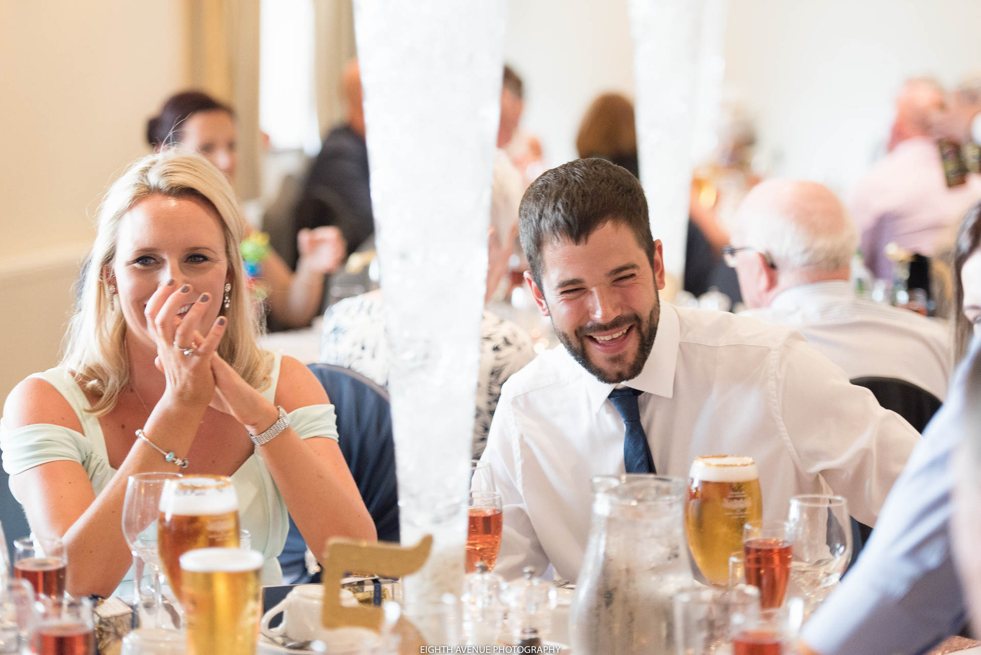 Wedding guest laughing at Beeston manor