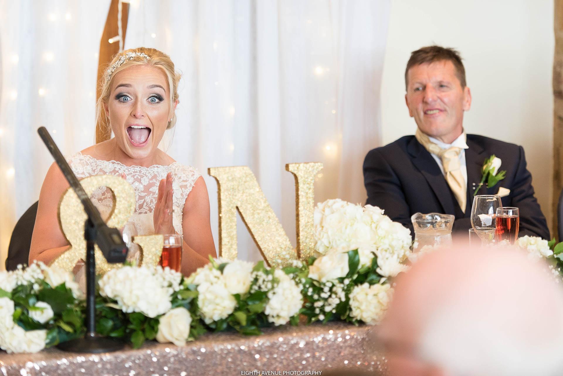 Shocked briide during speeches at Beeston Manor wedding