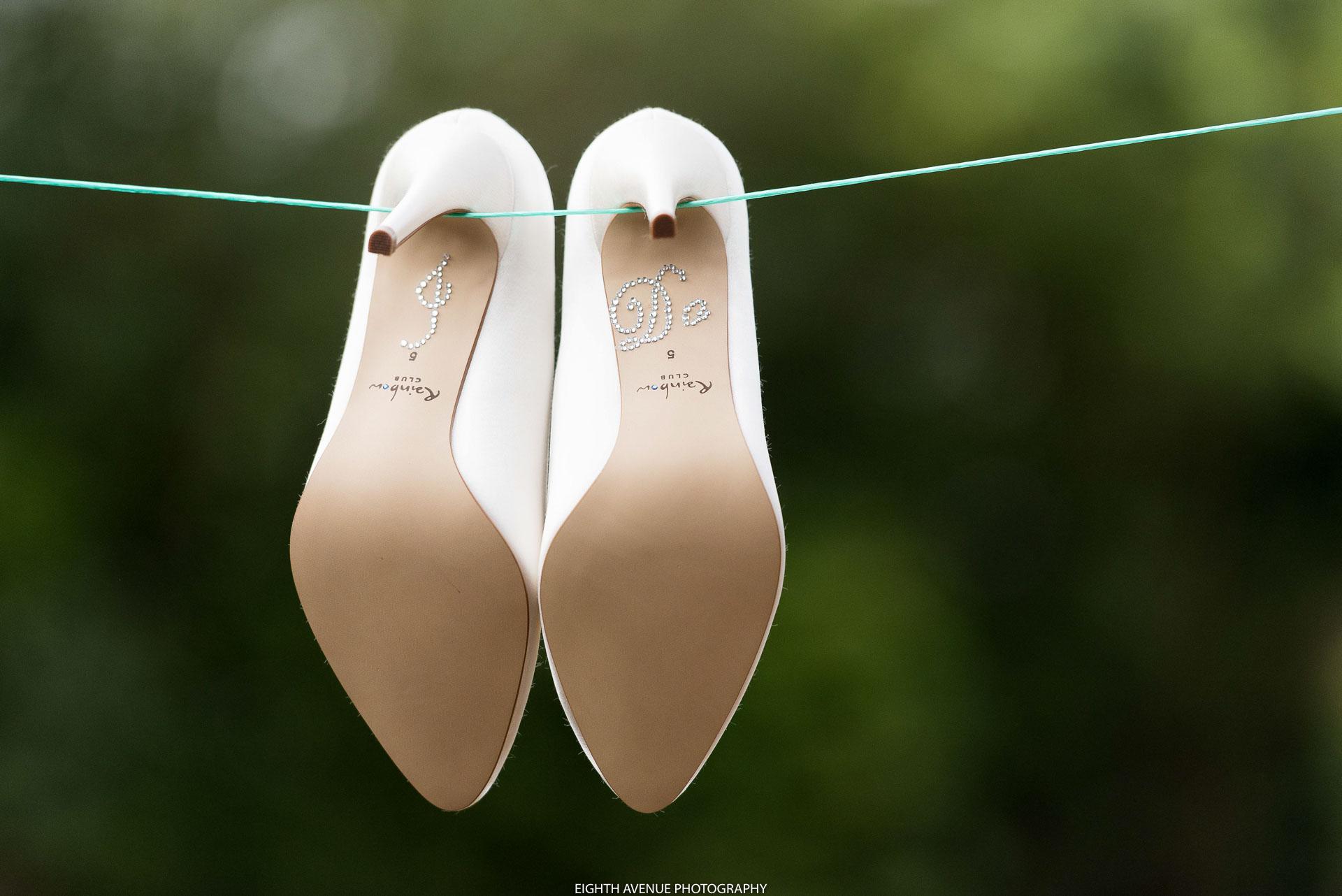 Bride's wedding shoes on clothes line