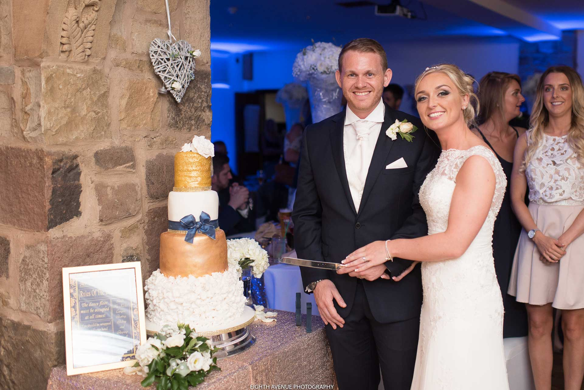 Bride and groom cutting the cake at Beeston Manor