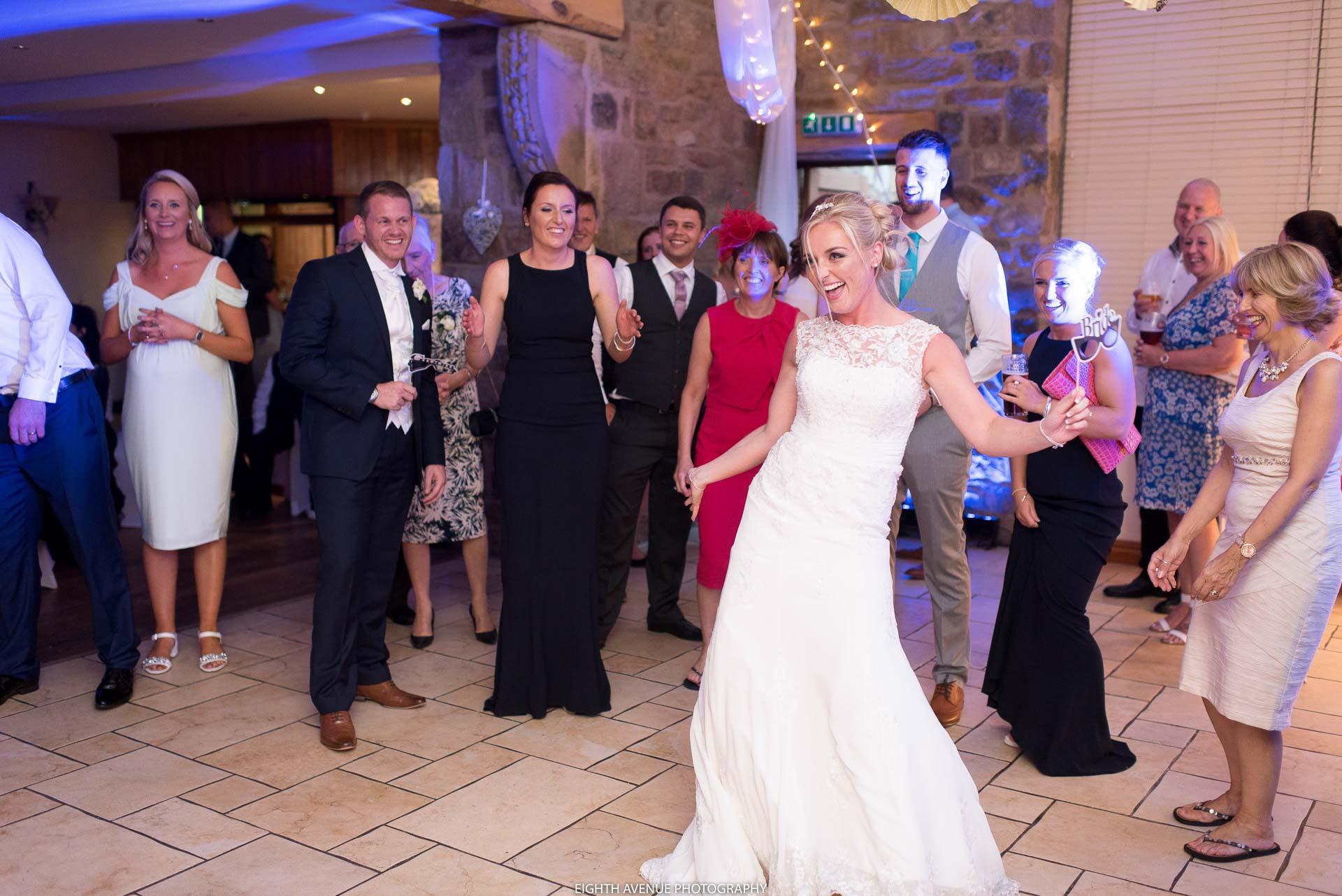 Bride dancing at Beeston Manor