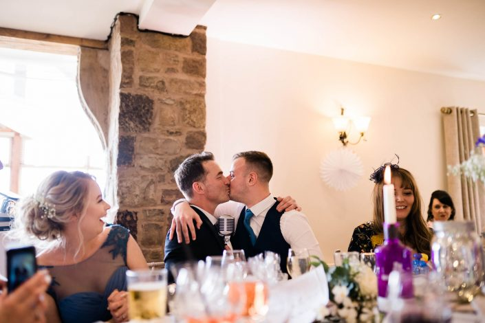 Howard Wing Kissing wedding guest