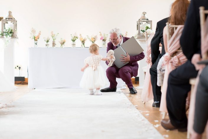 FLower girl with officiant at Beeston manor