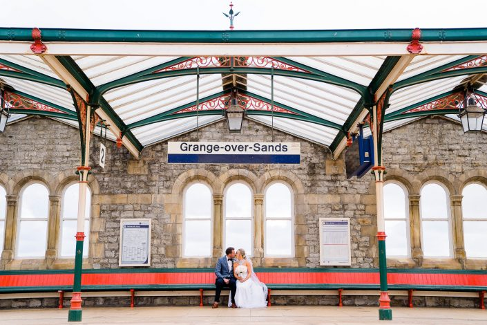 Bride and groom at Grange over sands train station