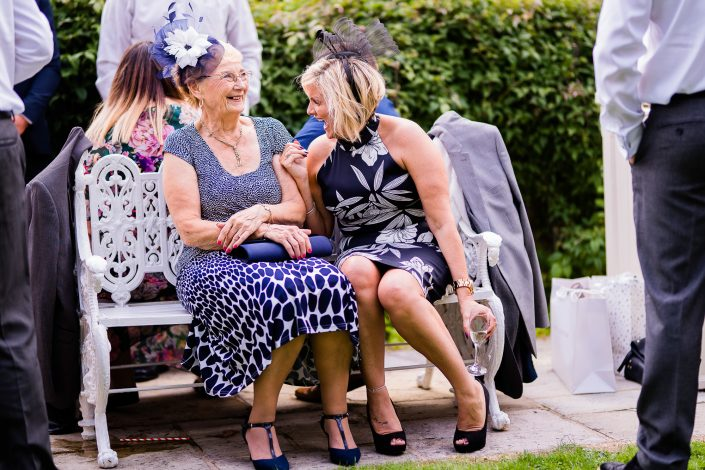 Ladies laughing at wedding
