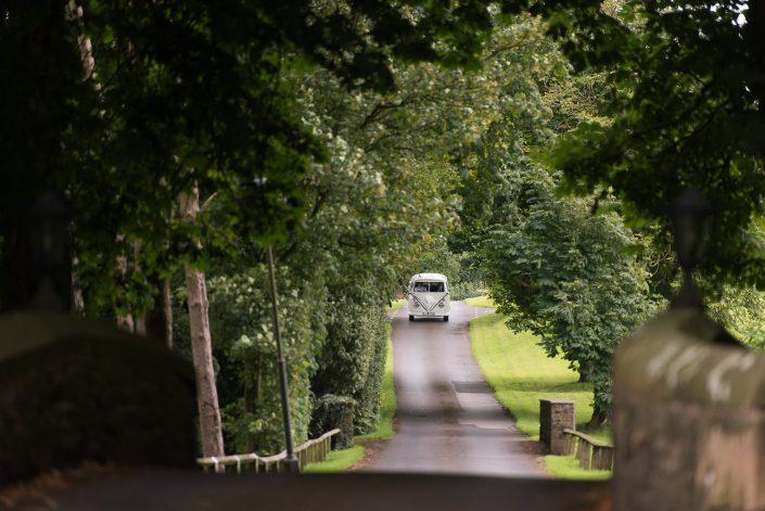 VW Camper arriving at wedding
