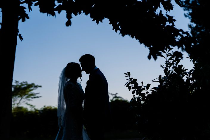 Bride and groom silhouette at Eaves Hall