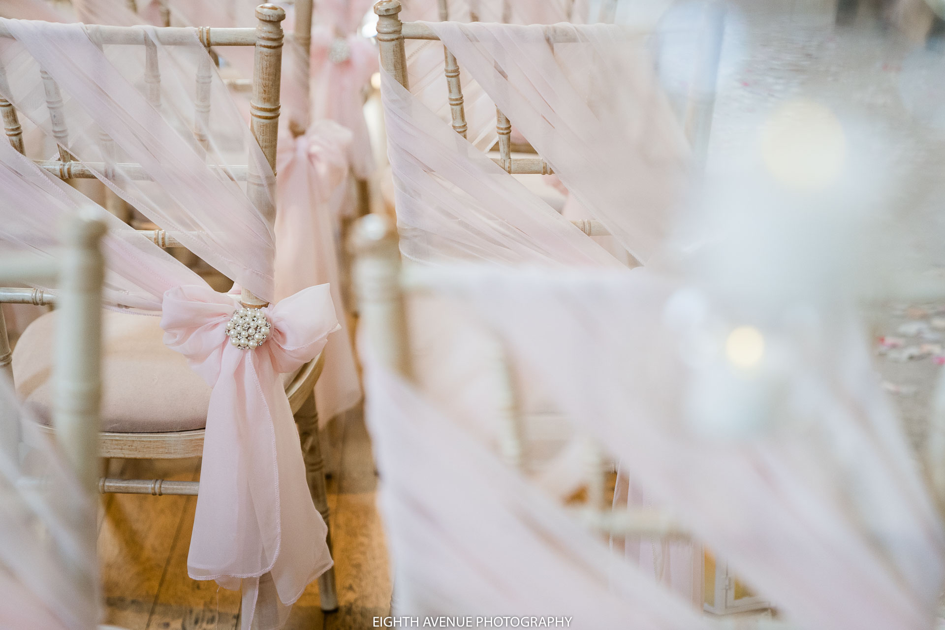 Pink sash on wedding chair ceremony