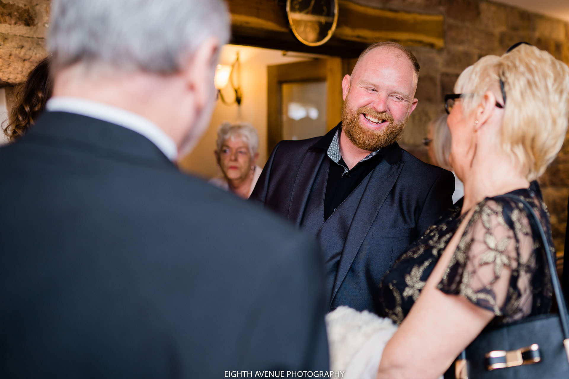 Wedding guests laughing at Beeston manor