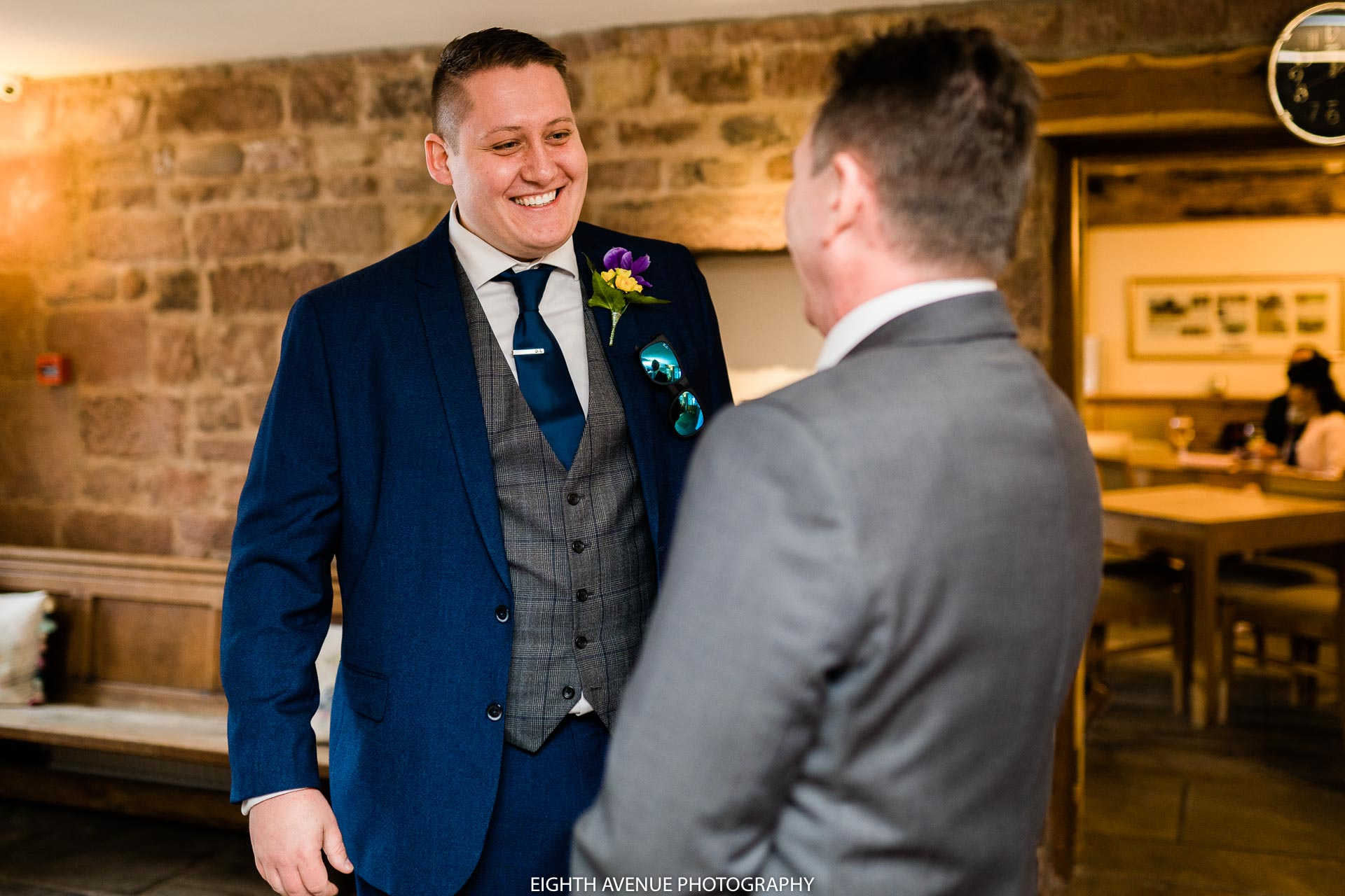 groom chatting to guest