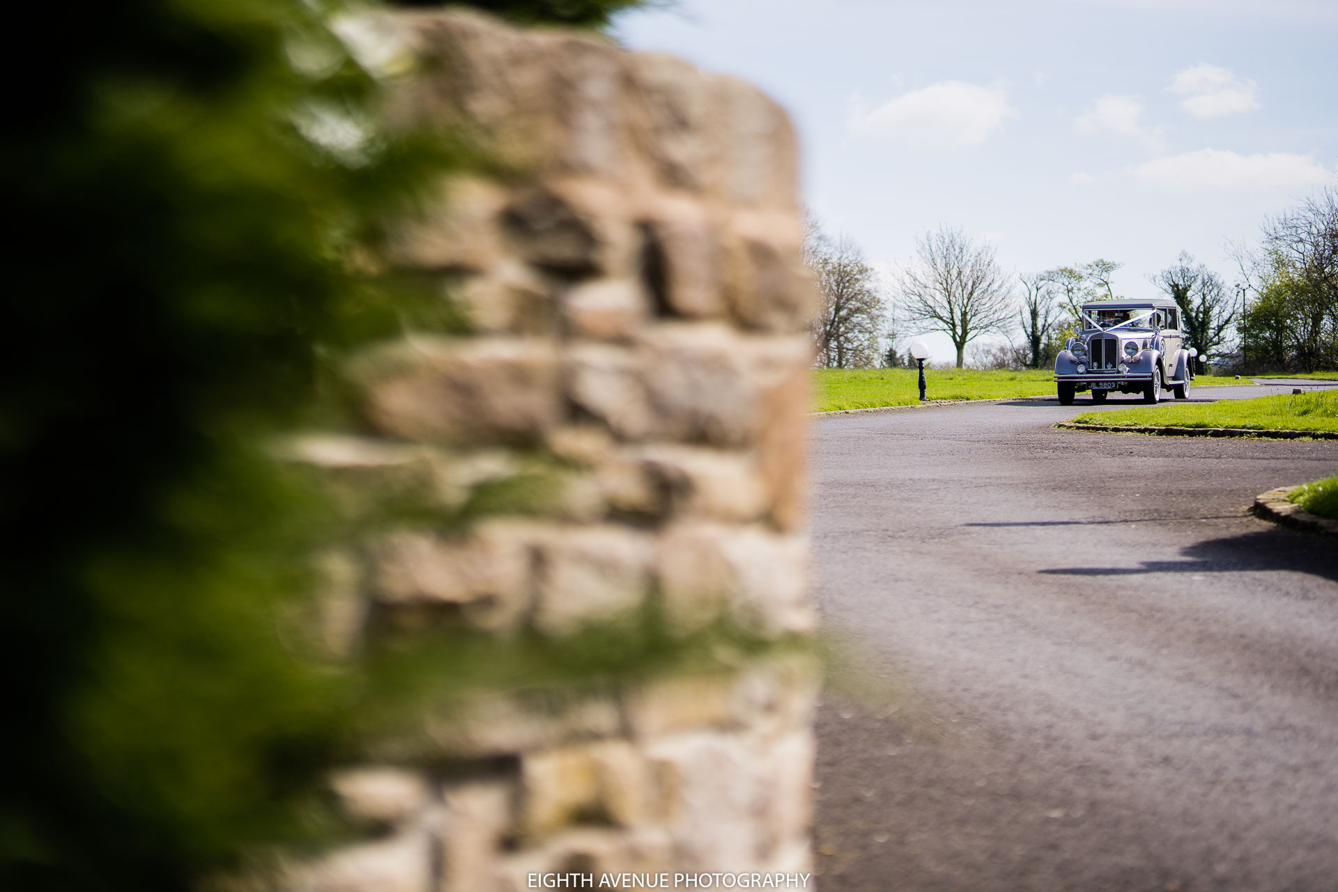 Wedding car arriving at Beeston Manor