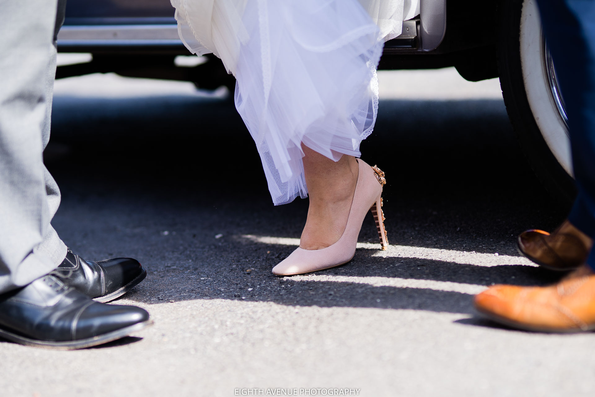 Bride exiting the wedding car