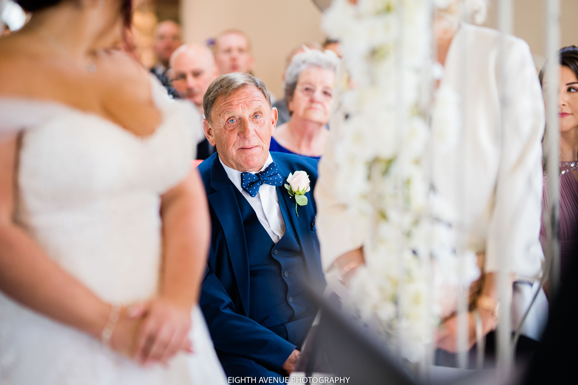 Father of the bride watching the wedding
