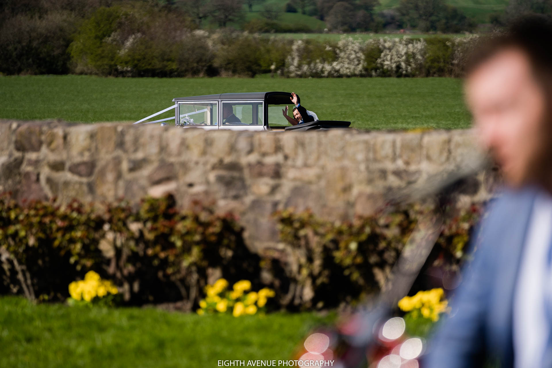 Bride and groom in car at wedding