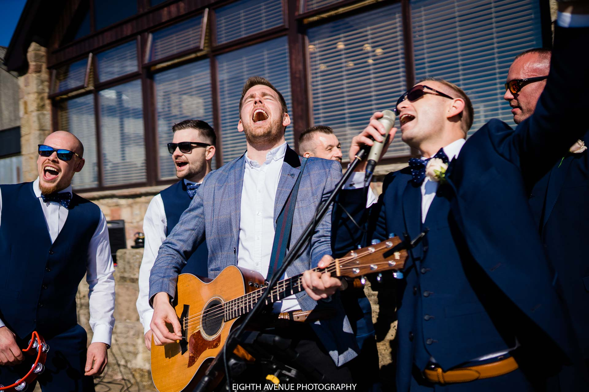 Alex Birtwell singing with groomsmen