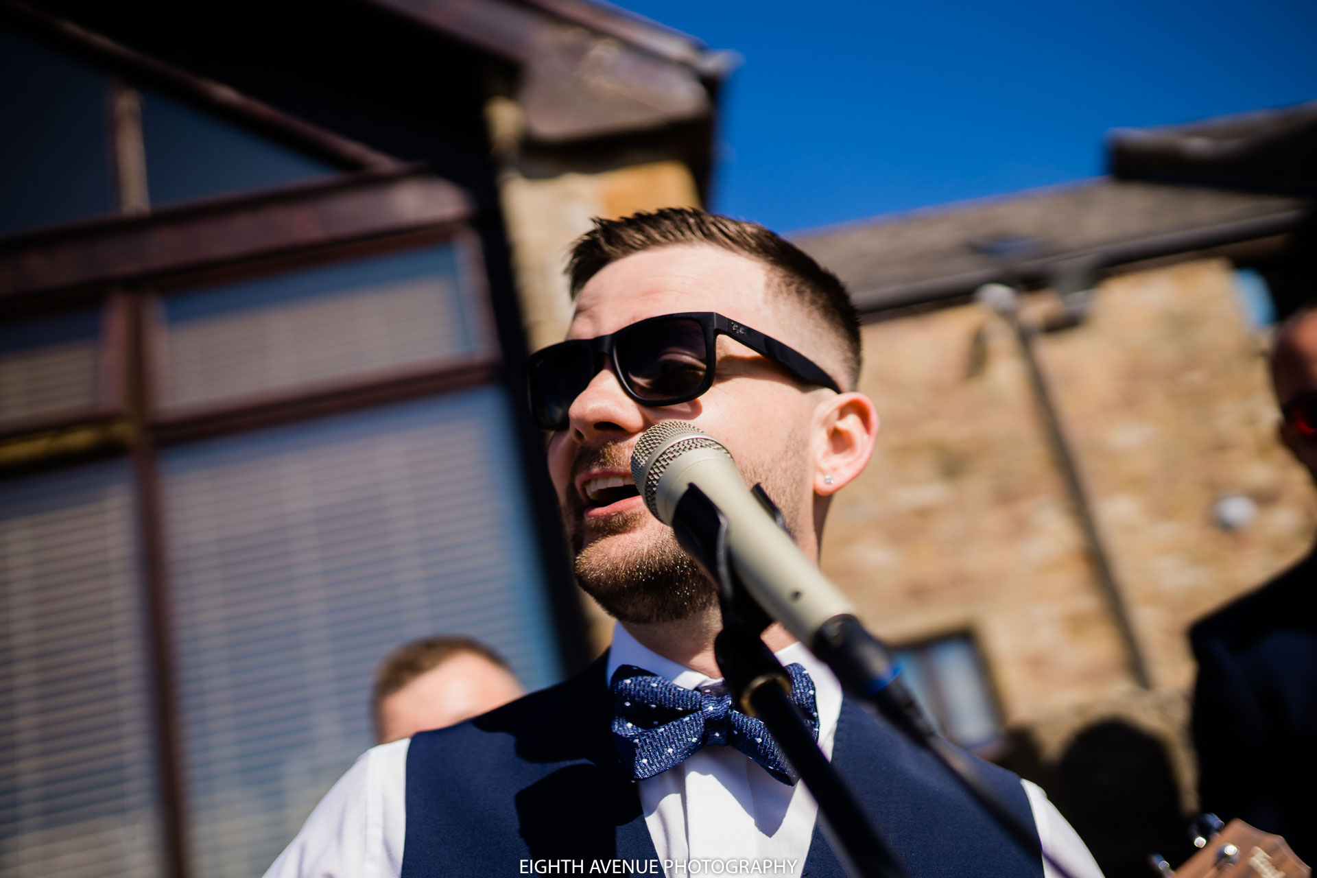 Groomsman singing