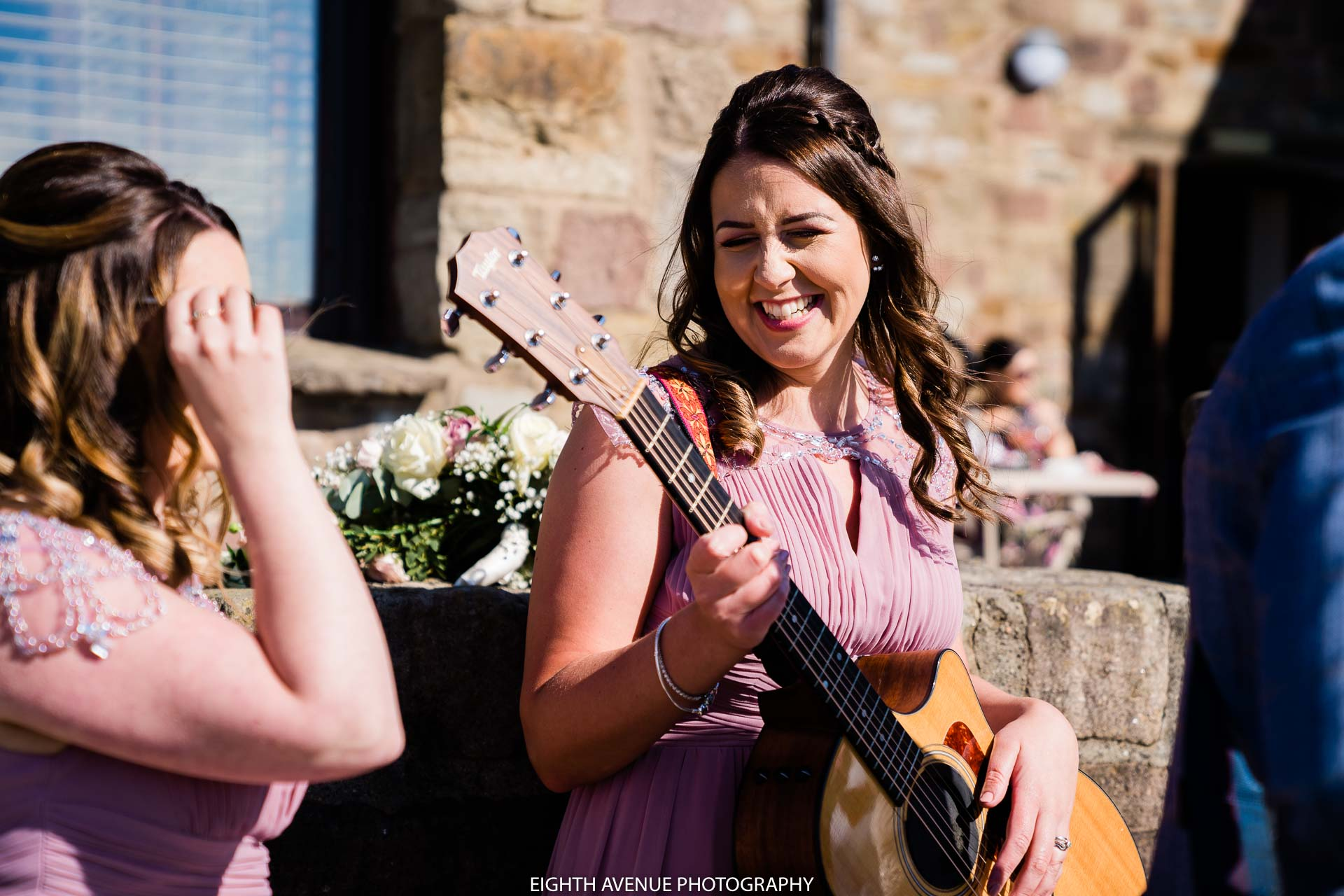 Bridesmaid with guitar