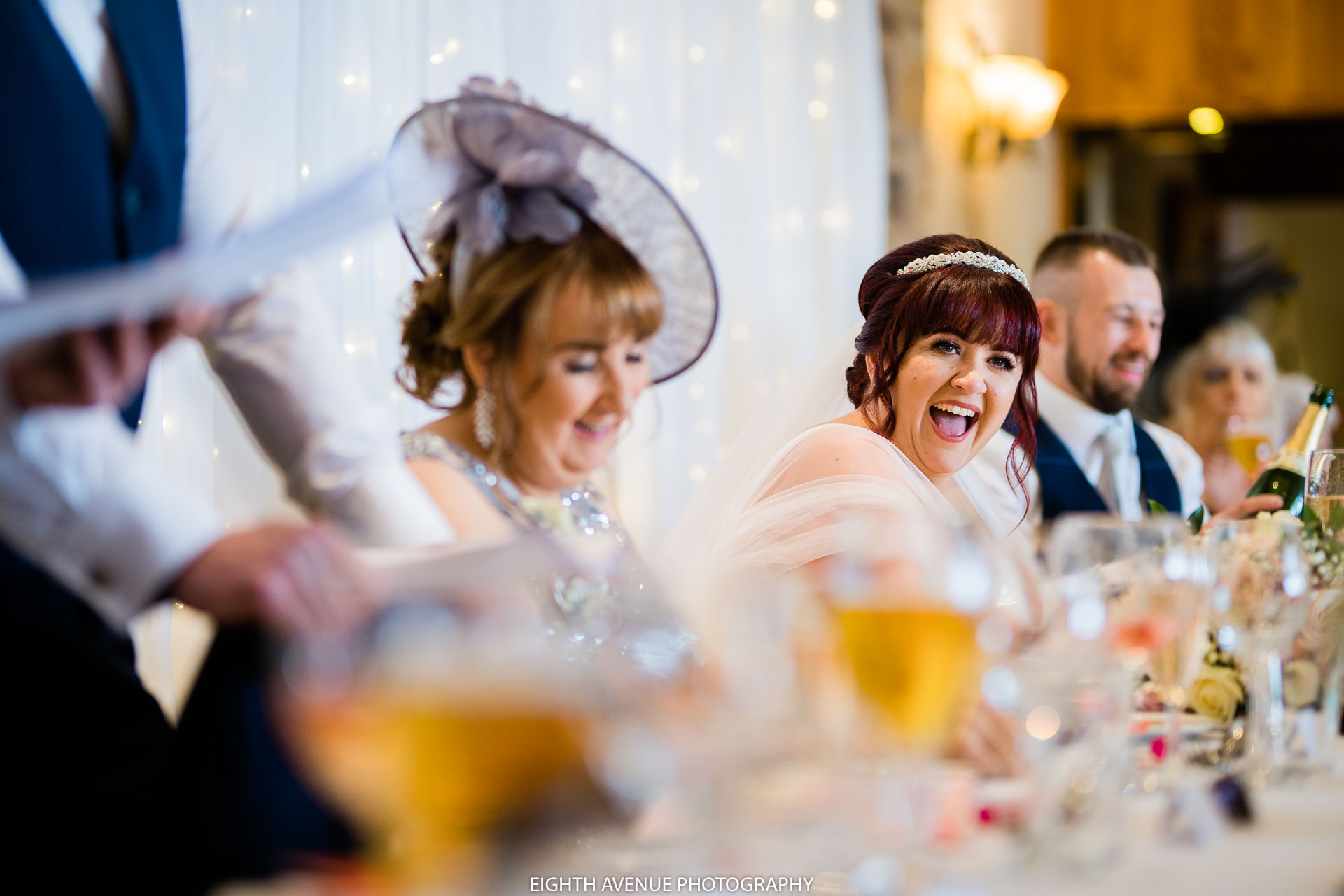 Bride laughing in speeches