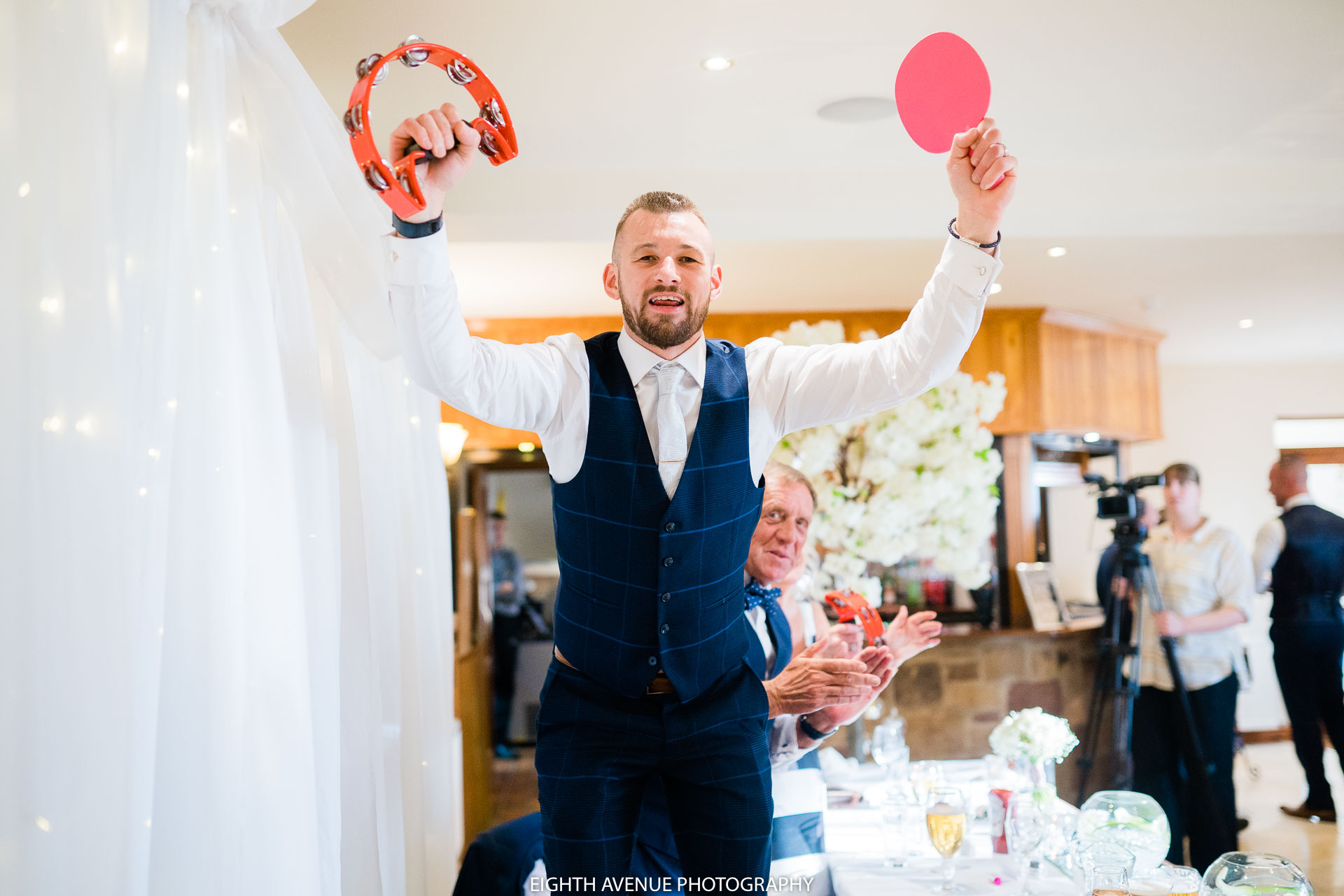 Groom standing on chair
