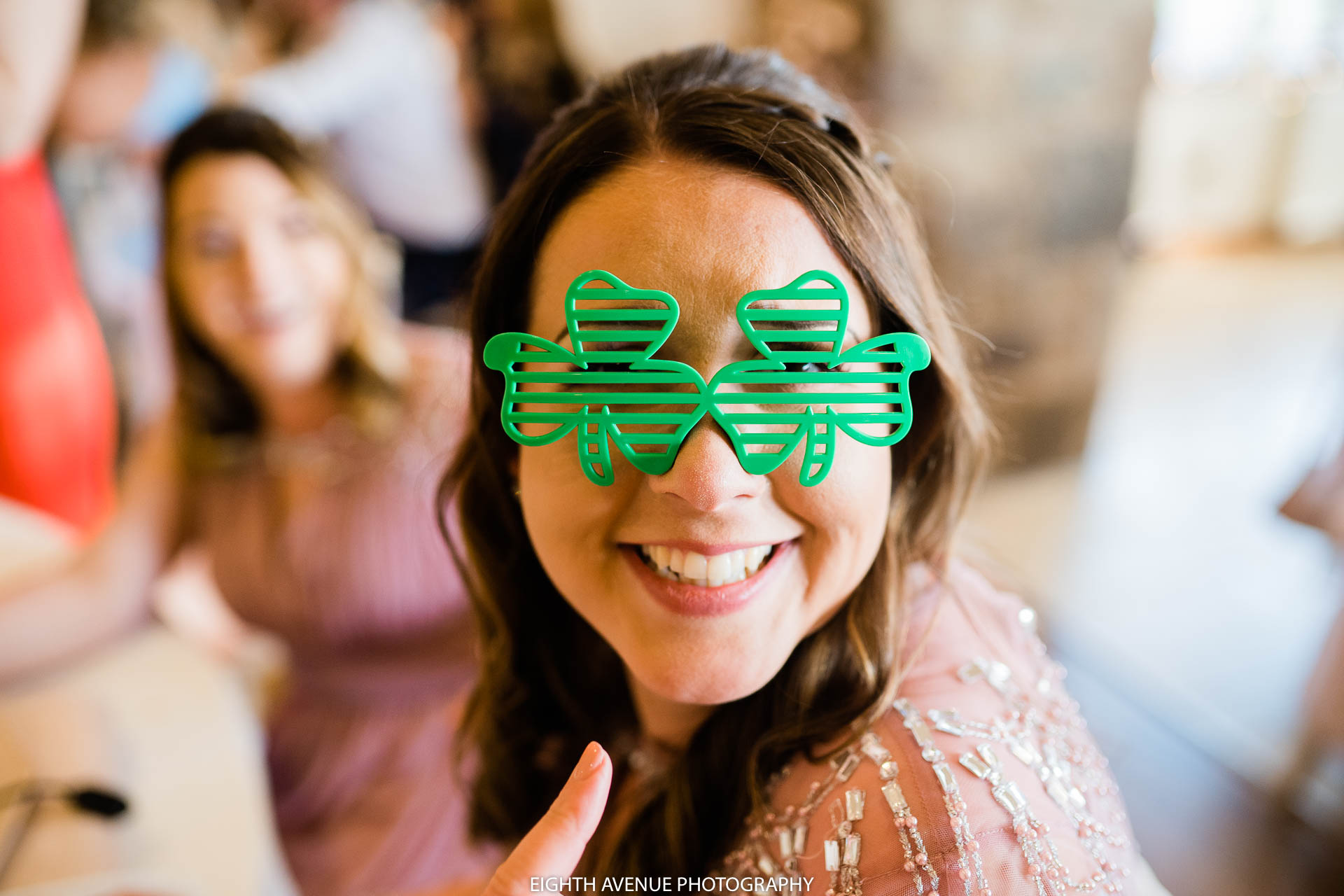 Wedding guest with clover glasses