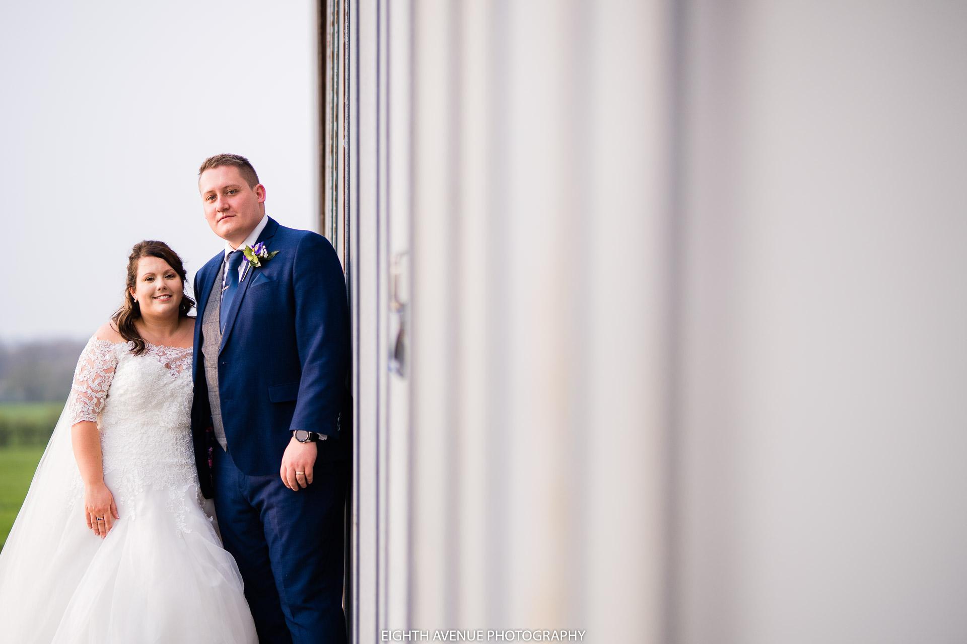 bride and groom next to Beeston hanger