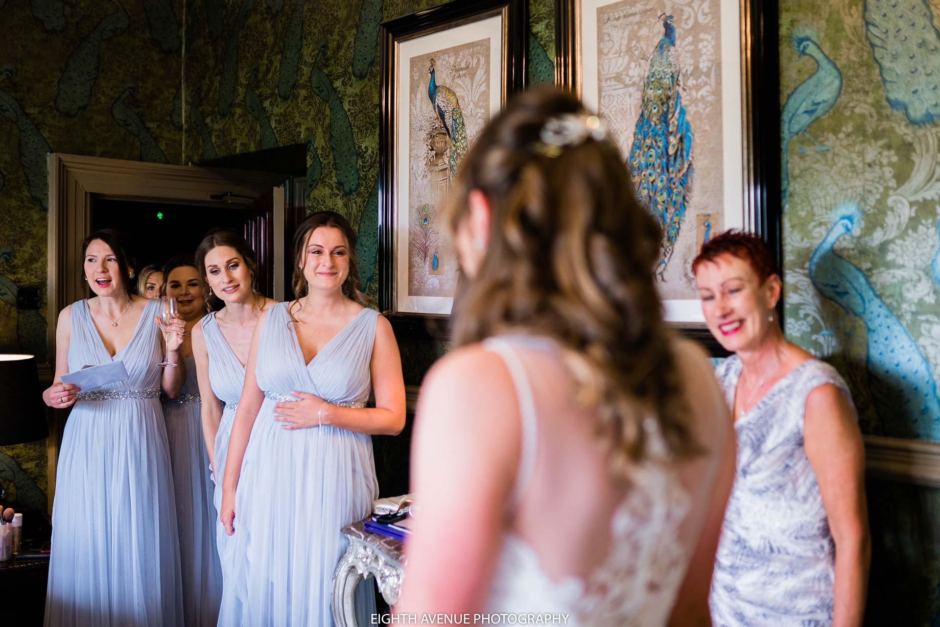 Bridesmaids seeing the bride