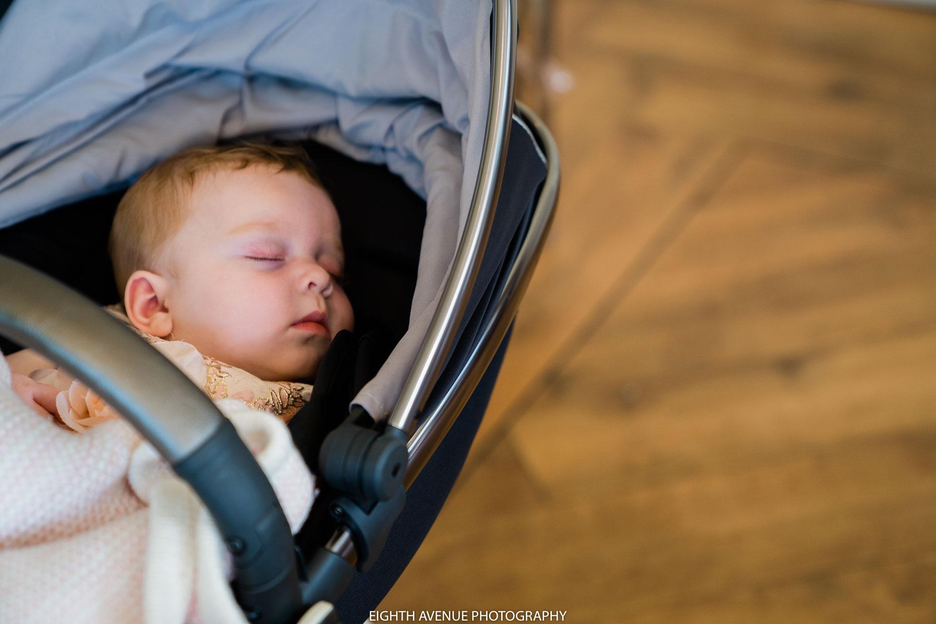 Baby asleep at wedding